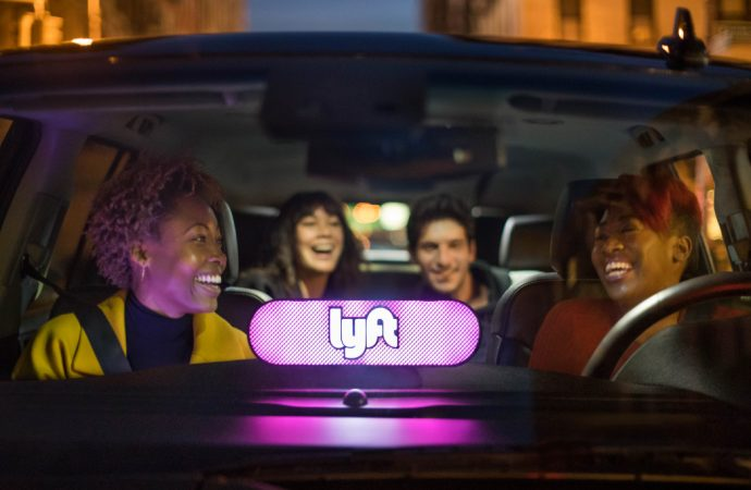 Lyft takes a hit after ride-hailing company sees more losses ahead